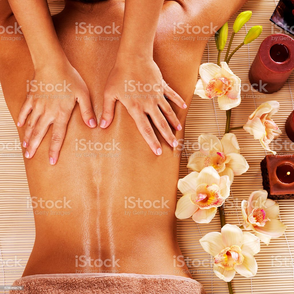 Masseur doing massage on woman back in spa salon stock photo