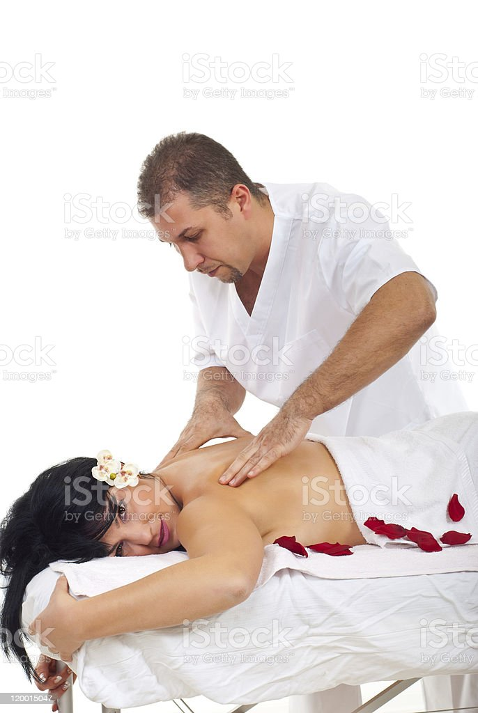 Masseur giving Shiatsu massage to woman royalty-free stock photo