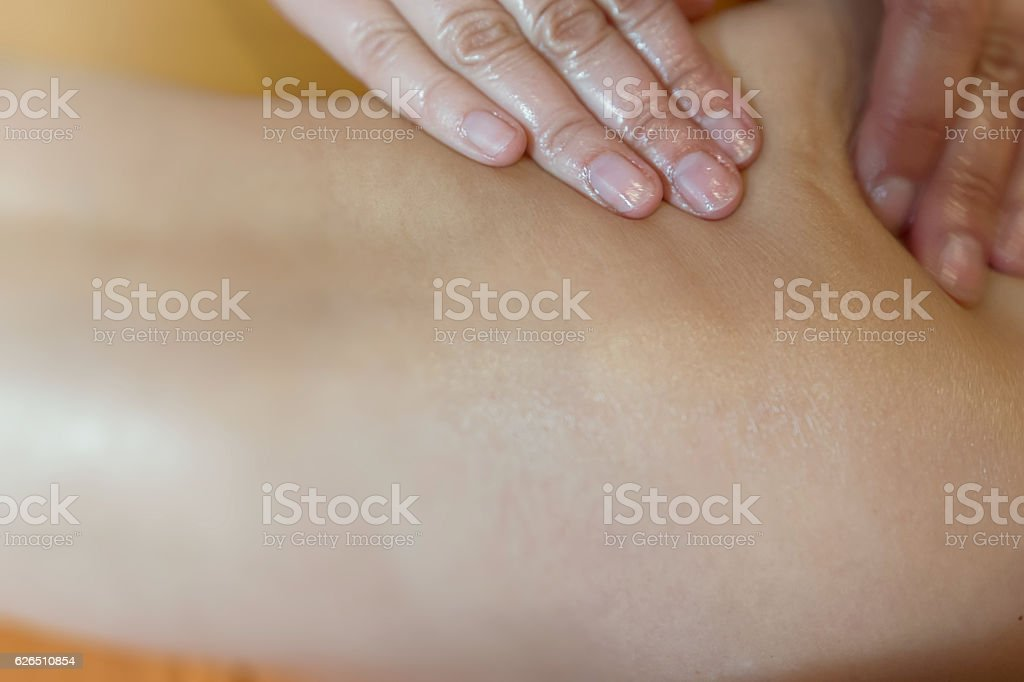 Masseur makes anti-cellulite massage for woman stock photo