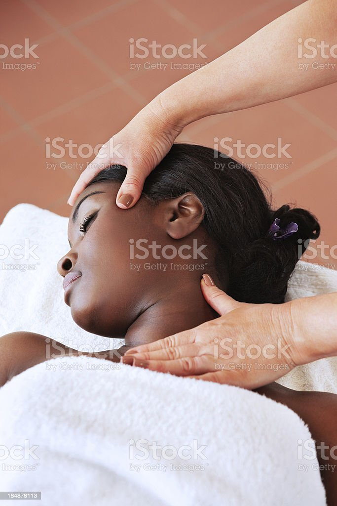 Masseuse Giving a Head Massage royalty-free stock photo