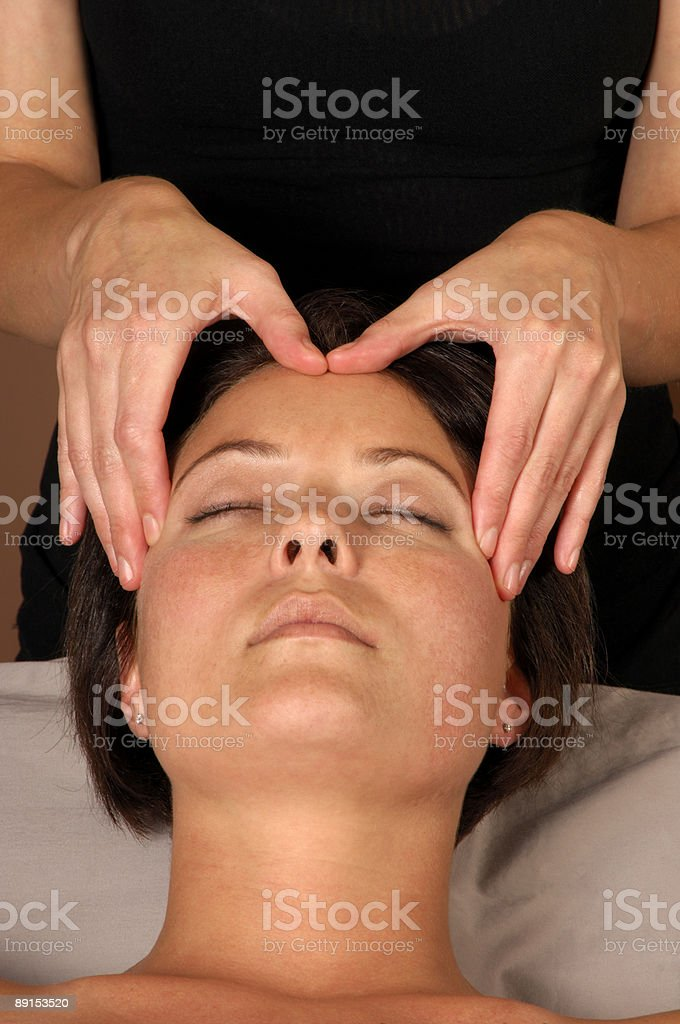 Masseuse Head Massage at Spa stock photo