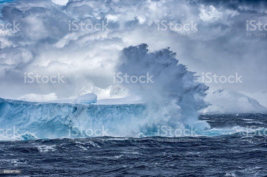 Massive Iceberg floating in Antarctica in a storm stock photo