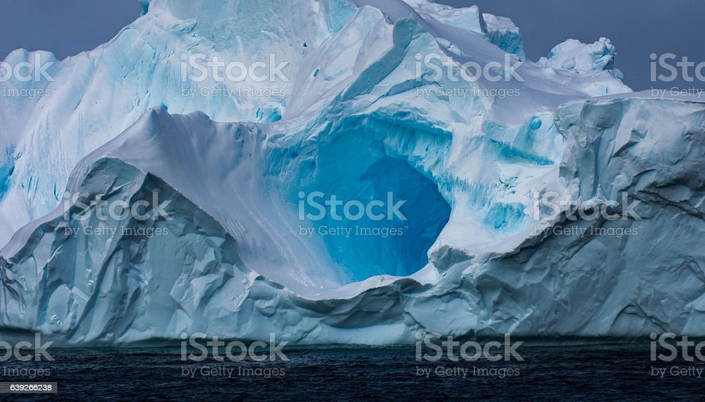 Massive Iceberg floating in Antarctica stock photo