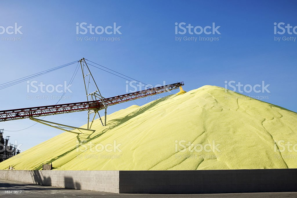 Massive mound of industrial sulfur at worksite stock photo