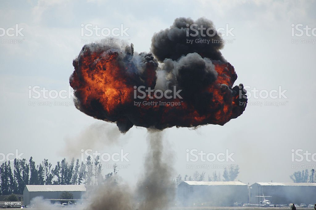 Massive mushroom shaped explosion at airport stock photo