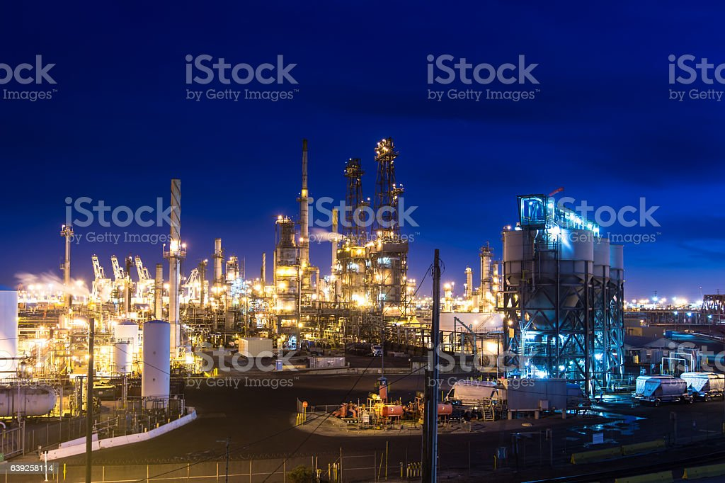 Massive Oil Refinery Lit Up at Night stock photo