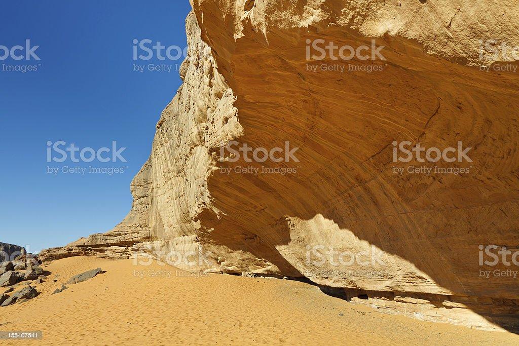 Massive Rock Face in the Sahara Desert stock photo