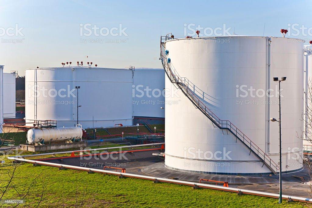 Massive white farming tanks with steps stock photo