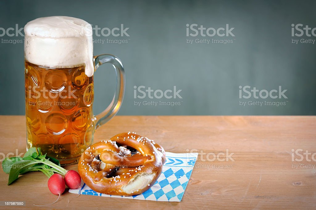 Masskrug beer, Pretzel and red radish royalty-free stock photo