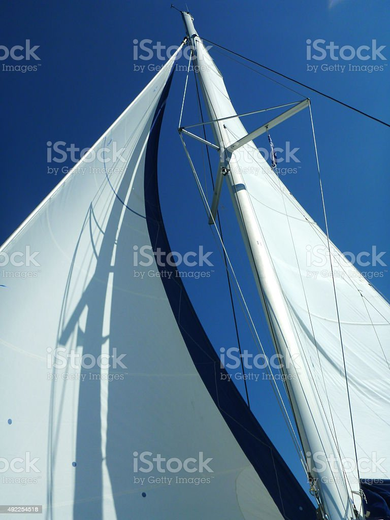 Mast and Sail on a Catamaran Yacht stock photo