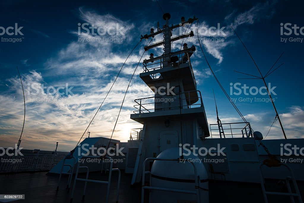 Mast of a greek ferry during sunset stock photo