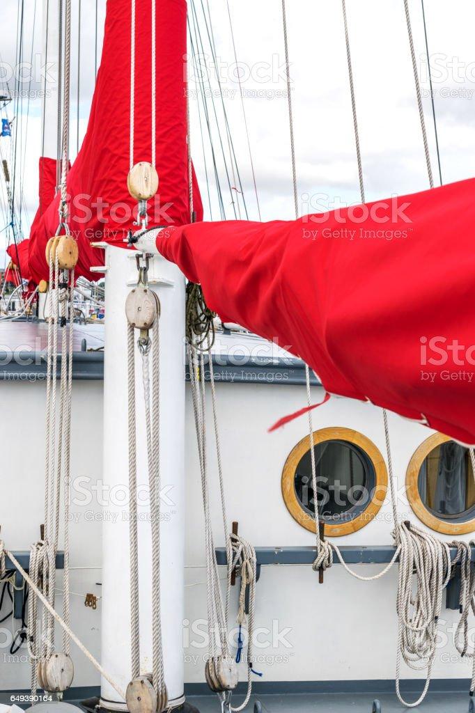 Mast, sails and window or porthole on a tall ship stock photo