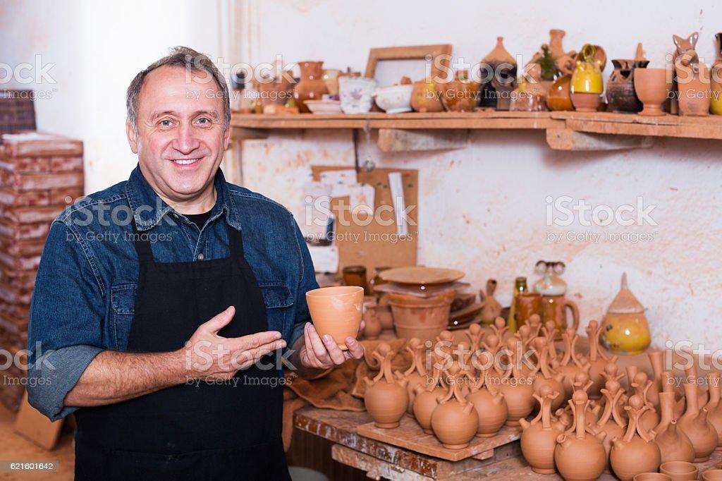 Master among the pottery stock photo