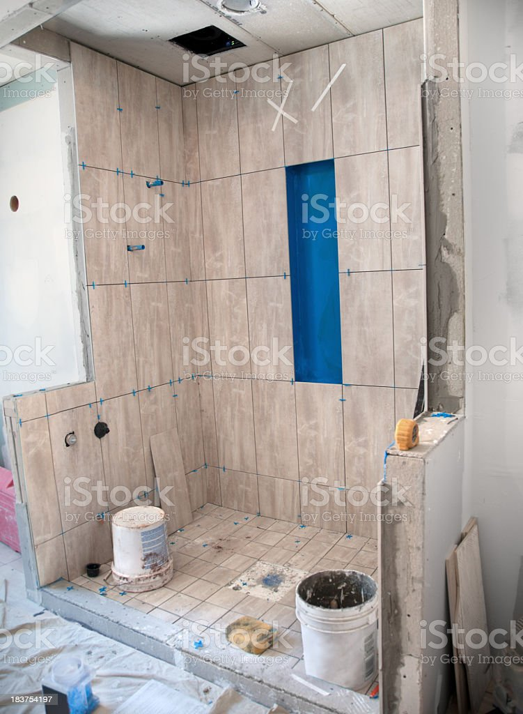 Master Bathroom Remodeling: Tiling in the Shower royalty-free stock photo