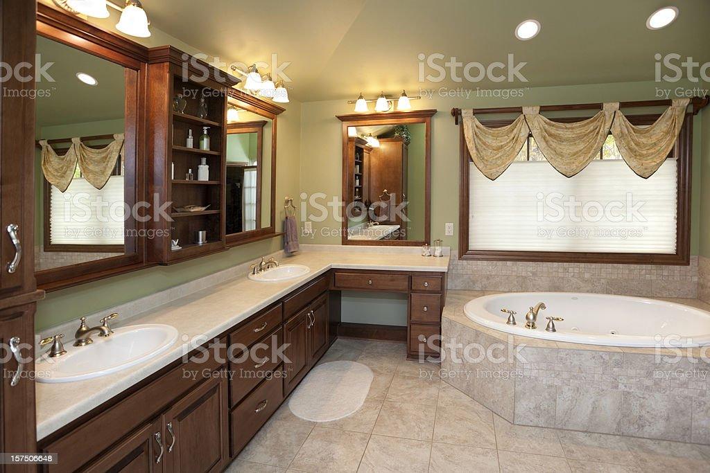 Master Bathroom, Tile Floor, Spa Tub, Hardwood Cabinets, Custom Lighting royalty-free stock photo