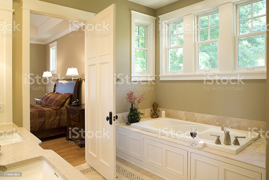 Master bed and bath. stock photo