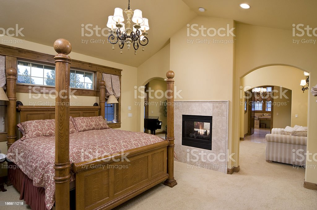 Master bedroom with four poster bed stock photo