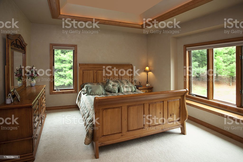 Master Bedroom With Pine and Crown Moulding stock photo