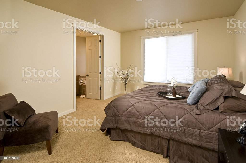 Master bedroom with sitting area royalty-free stock photo