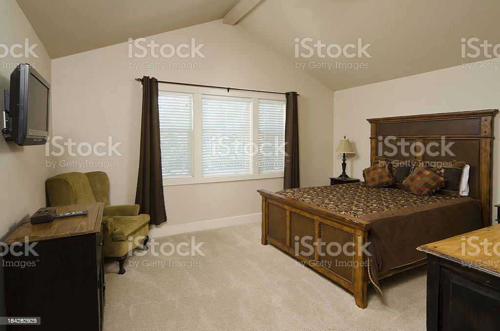Master bedroom with television royalty-free stock photo
