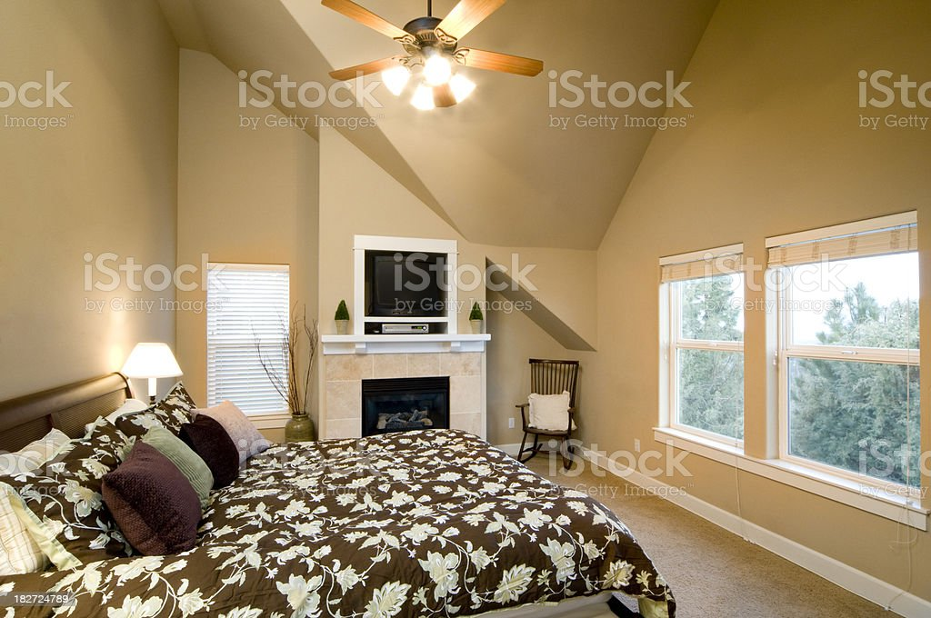 Master bedroom with tiled fireplace stock photo