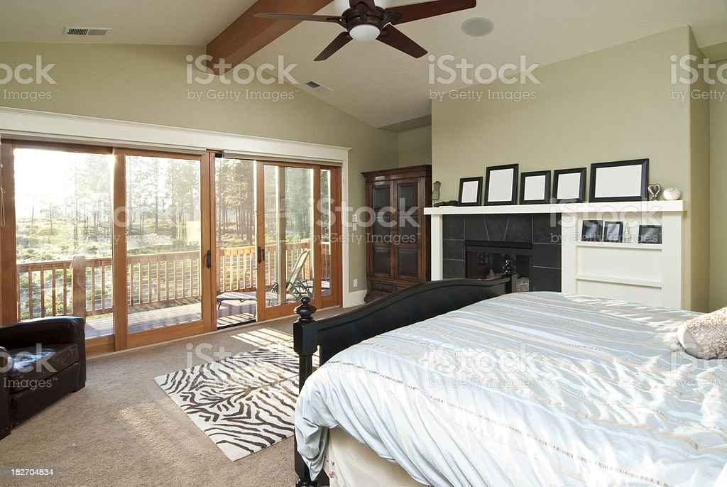 Master bedroom with view of the outdoors royalty-free stock photo