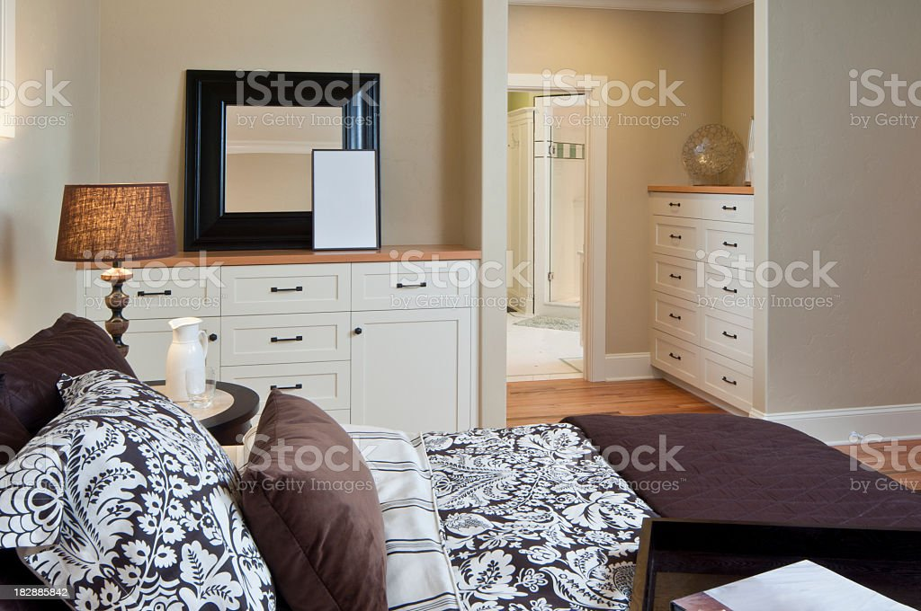 Master bedroom with view to master bathroom stock photo