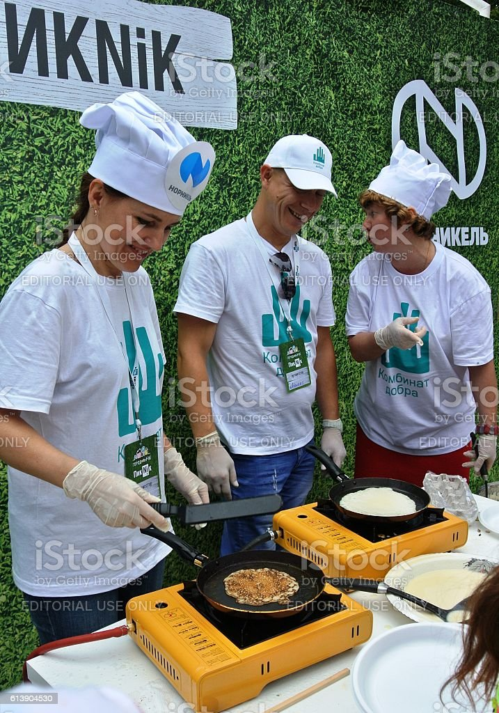 Master class on baking pancakes in city park stock photo