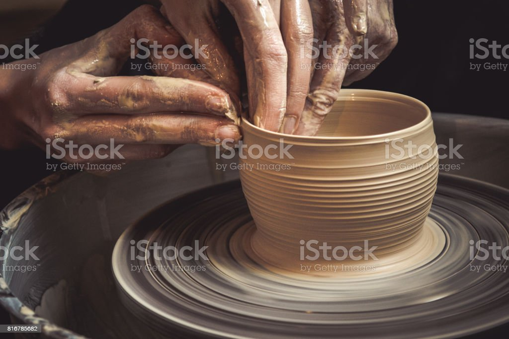 Master class on modeling of clay on a potter's wheel stock photo