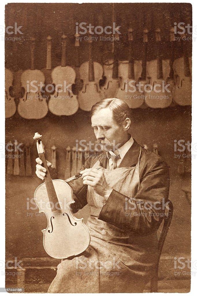 Master Craftsman Violin Maker or Luthier stock photo