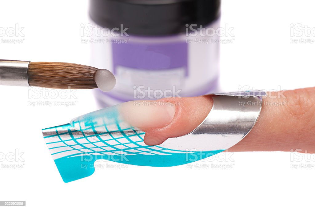Master make nail extension. Finger closeup isolated on white background. stock photo