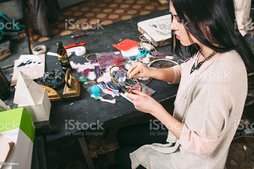 master makes new  Dreamcatcher in art studio. stock photo