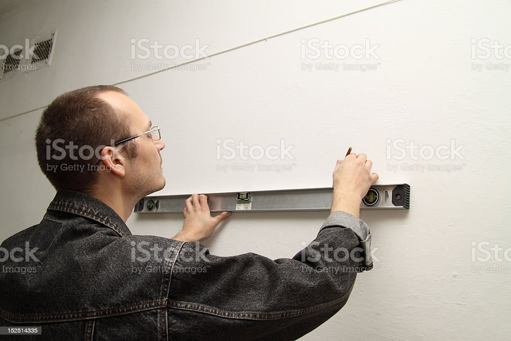 Master measures the wall royalty-free stock photo