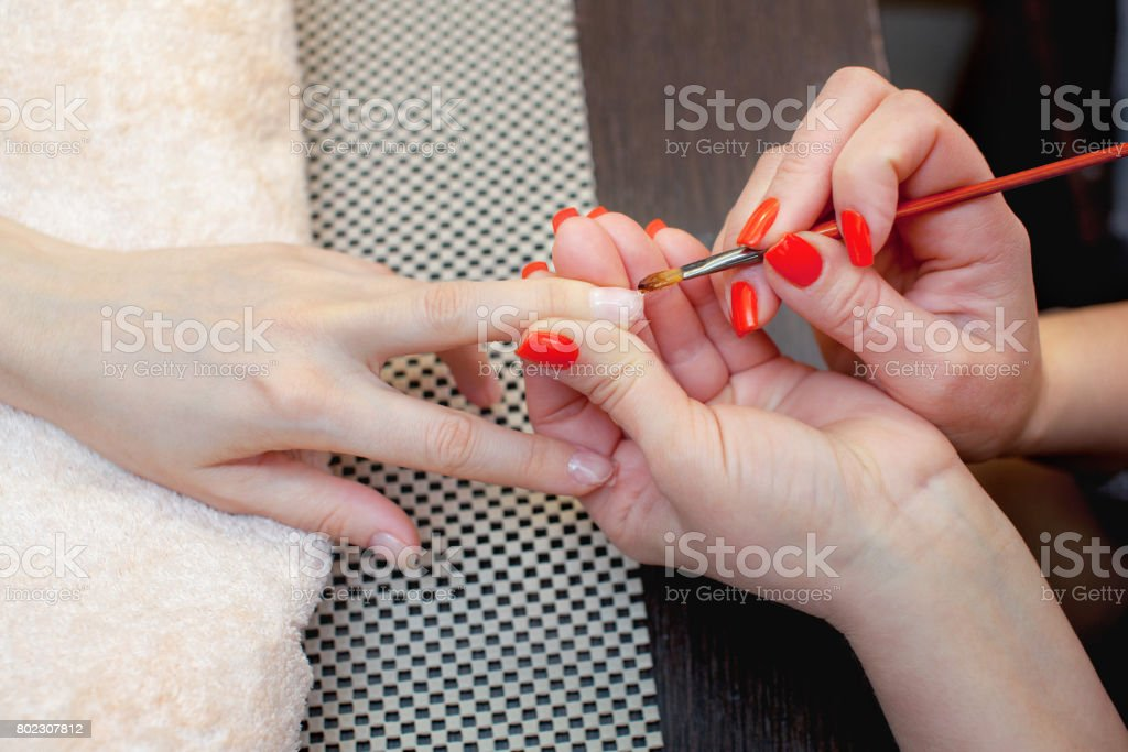 Master of manicure makes nail extensions gel in the beauty salon. stock photo