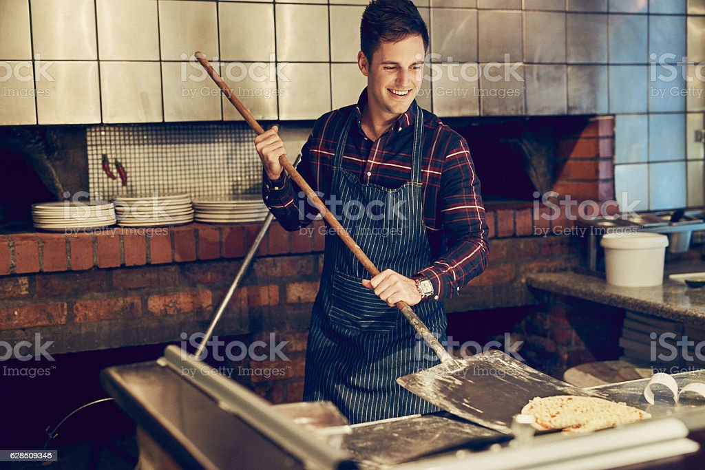 Master pizza maker at work stock photo