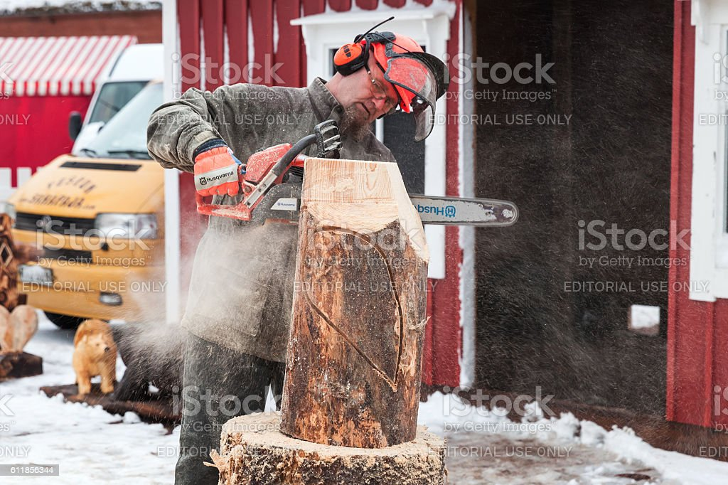 Master sculptor with a chainsaw stock photo