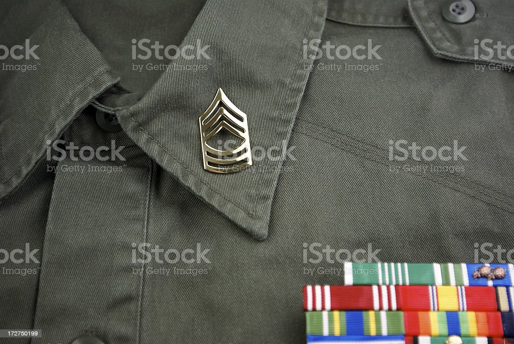 Master Sergeant Insignia with Ribbons royalty-free stock photo