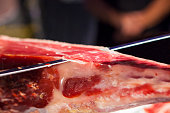 Master slicer cutting iberian cured ham