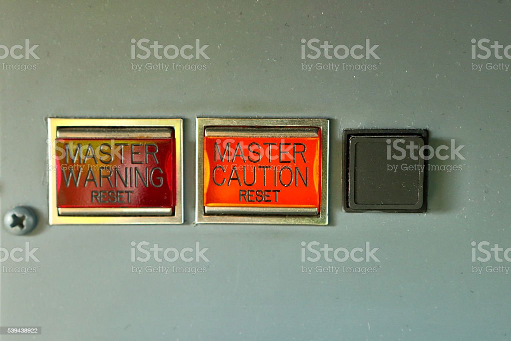 Master warning and caution reset stock photo