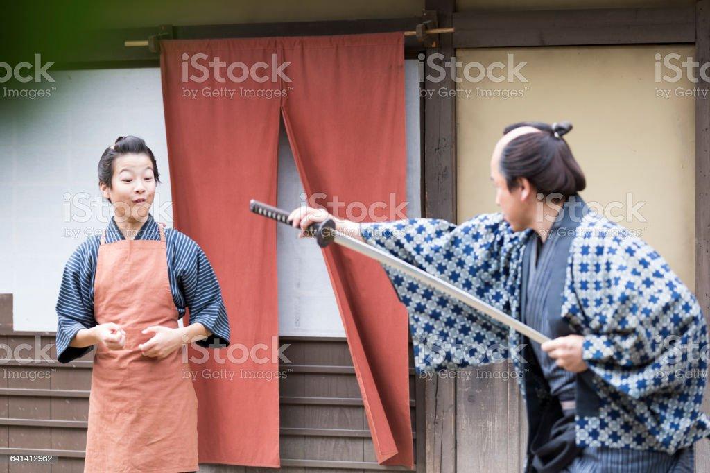 Master, you are amazing with Samurai sword stock photo