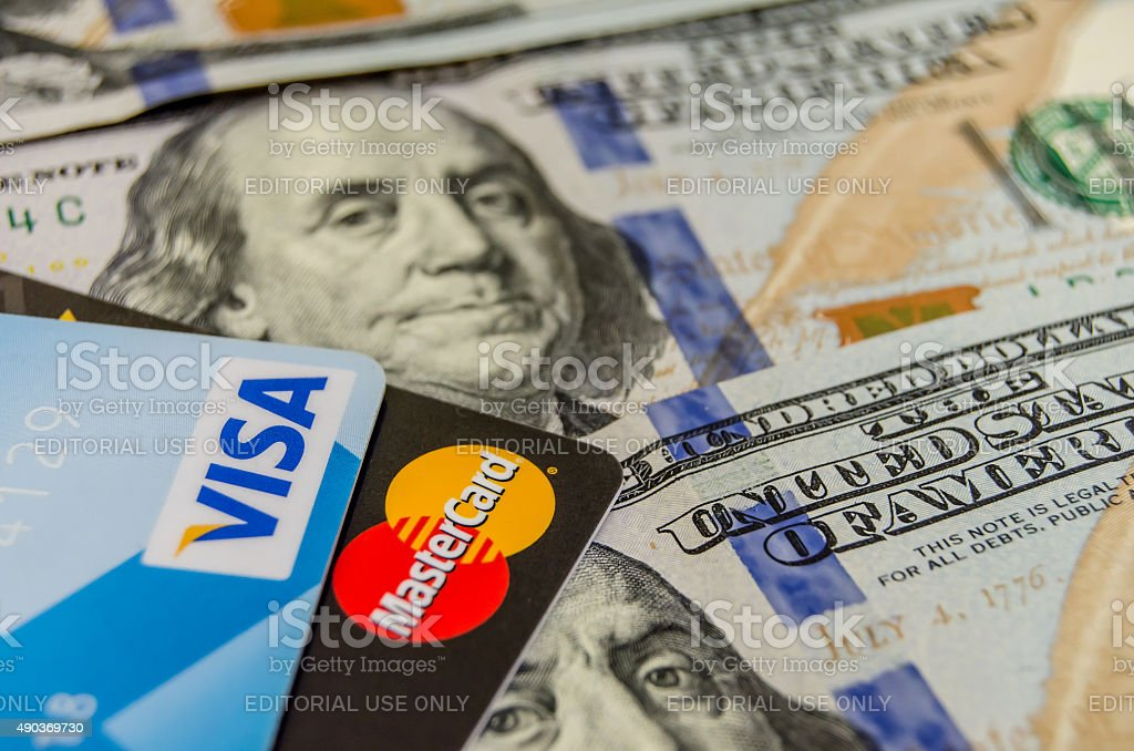 MasterCard and Visa credit cards above american dollars stock photo