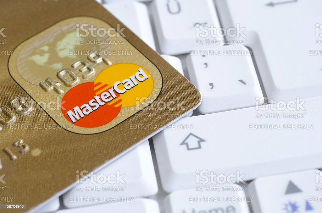 Mastercard credit cards on the keyboard stock photo