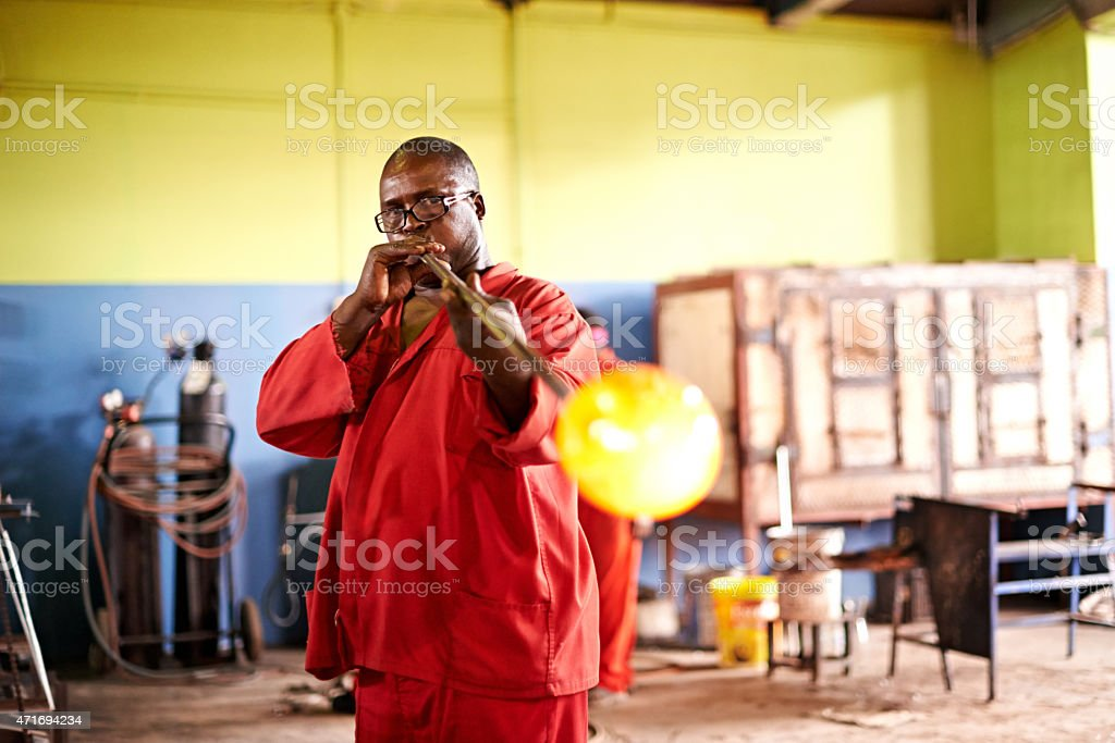 Mastering the art of glassblowing stock photo