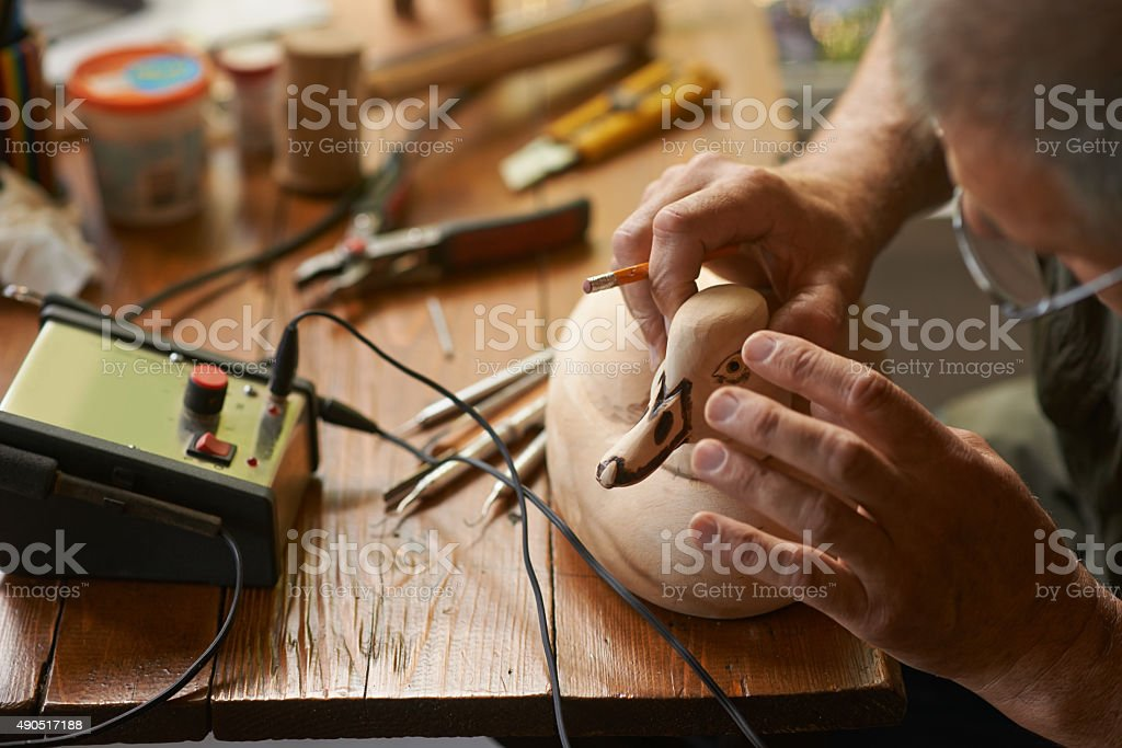 Mastering the art of woodcarving stock photo