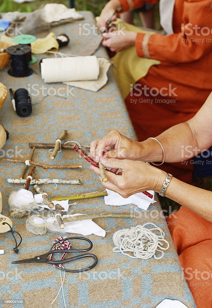 Masters taught to make dolls stock photo