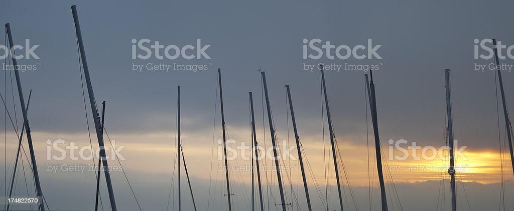 Masts at sunset royalty-free stock photo
