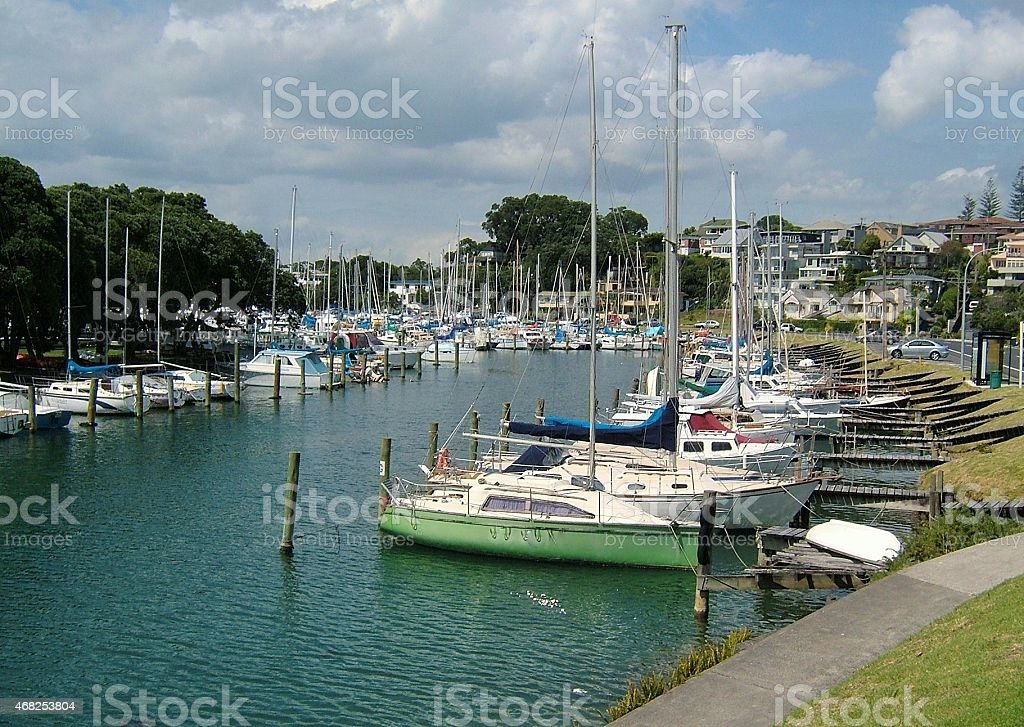 Masts galore at a boat marina in suburban town stock photo