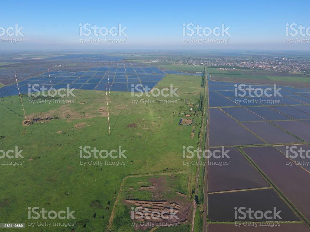 Masts longwave antennas communication among the rice fields flooded stock photo
