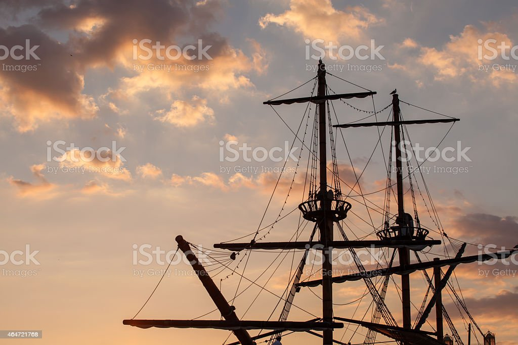 Masts of a pirate ship on sunset stock photo