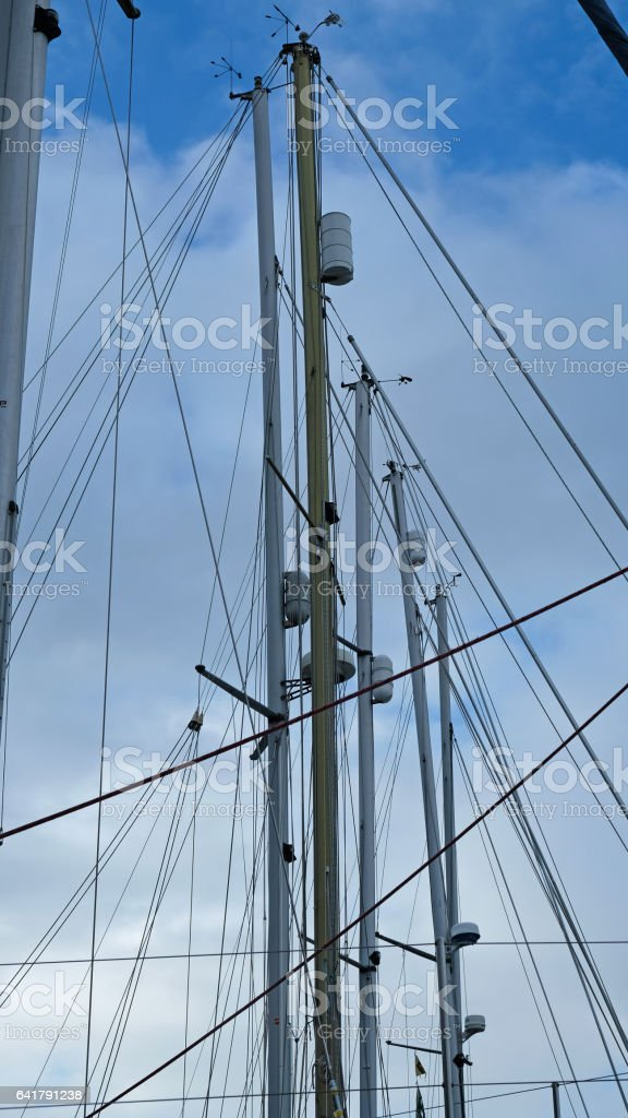 Masts of laid up yachts in winter stock photo